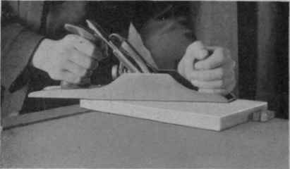 Fig. 1. Holding Wood Between Bench Pegs and Planing Surface.